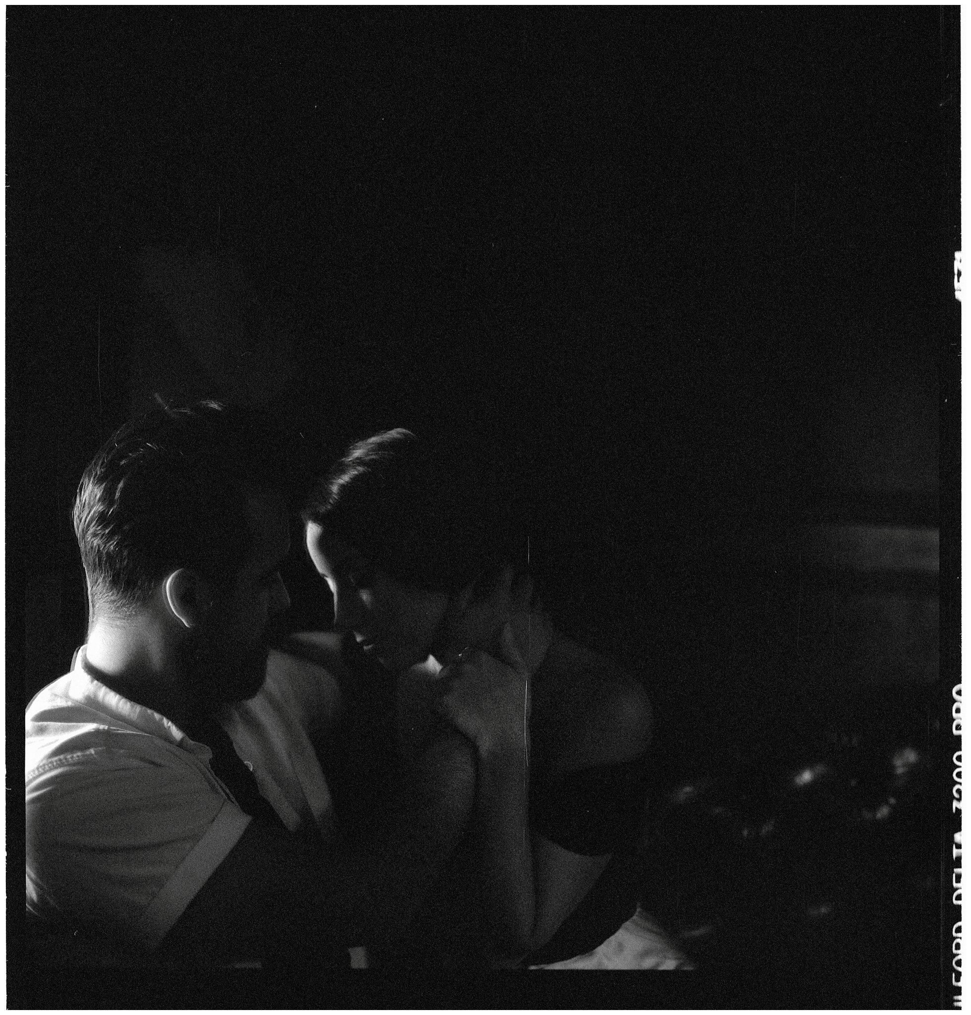 two people kissing film analog photography black and white ilford delta 3200